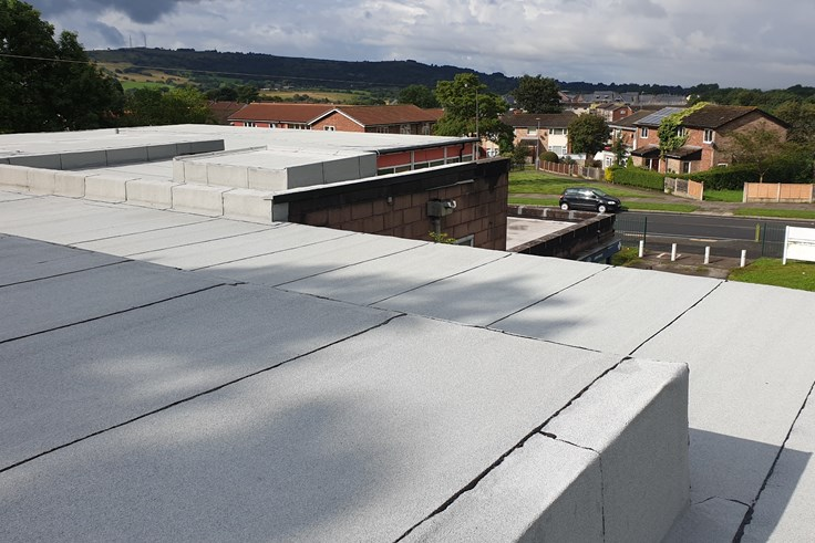 Property gallery image: Installing an environmentally friendly roof at a health clinic